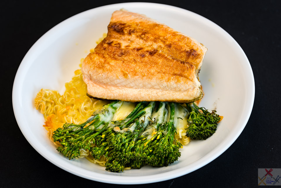 Crispy skin salmon on crispy cheesy noodles with broccoli Gary Lum