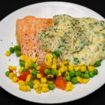 Monday baked salmon dinner with cheesy white sauce and vegetables Fancy baked salmon Gary Lum