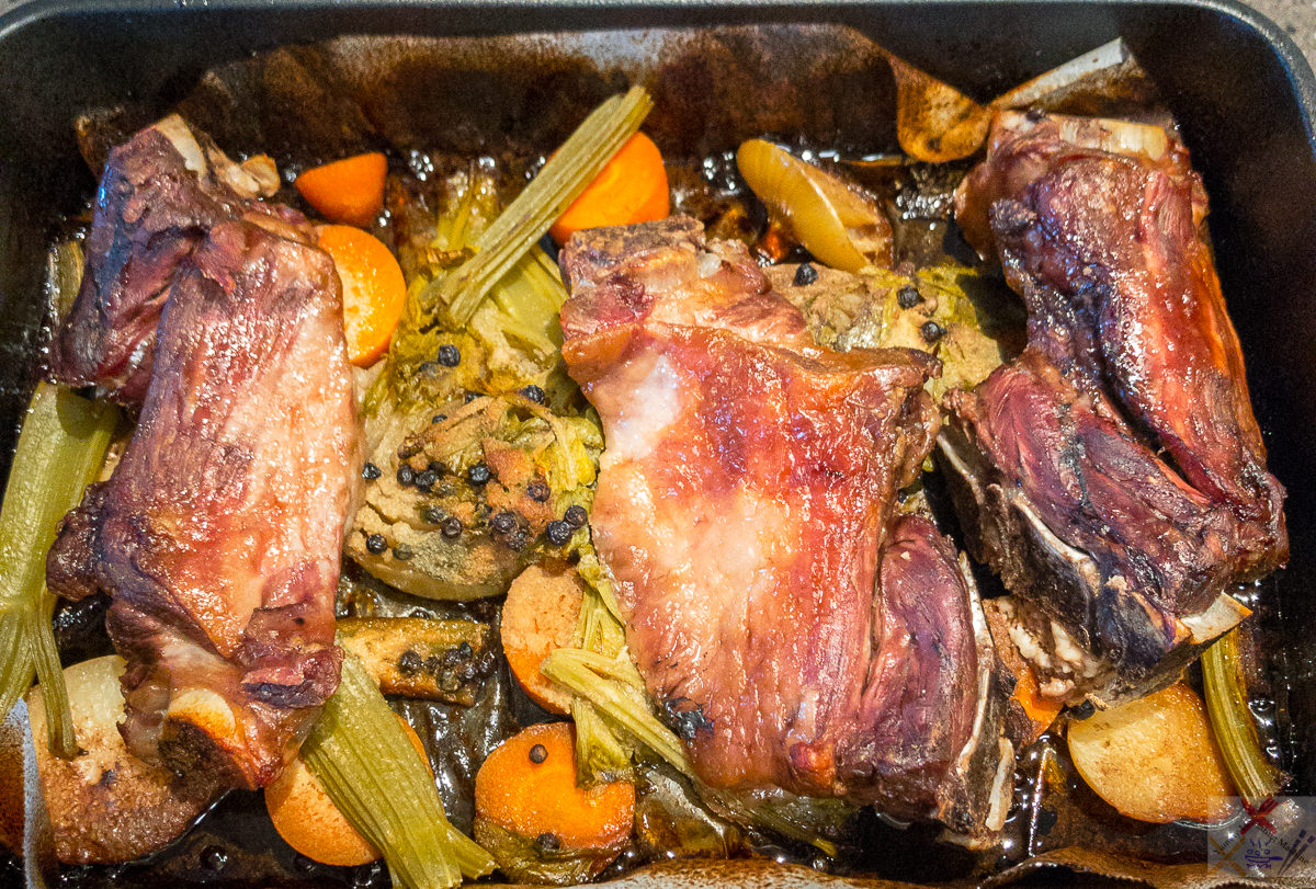 Lamb bones and vegetables in a baking tray after four hours slowly roasting Gary Lum