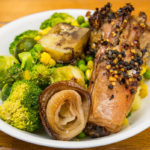Slowly roasted lamb bones with mashed potato, Brussels sprouts, broccoli, peas and corn Gary Lum