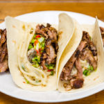 Creamy udon noodles tacos with slowly roasted lamb Gary Lum