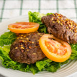 Home minced blue cheese burger with tomato and lettuce Gary Lum