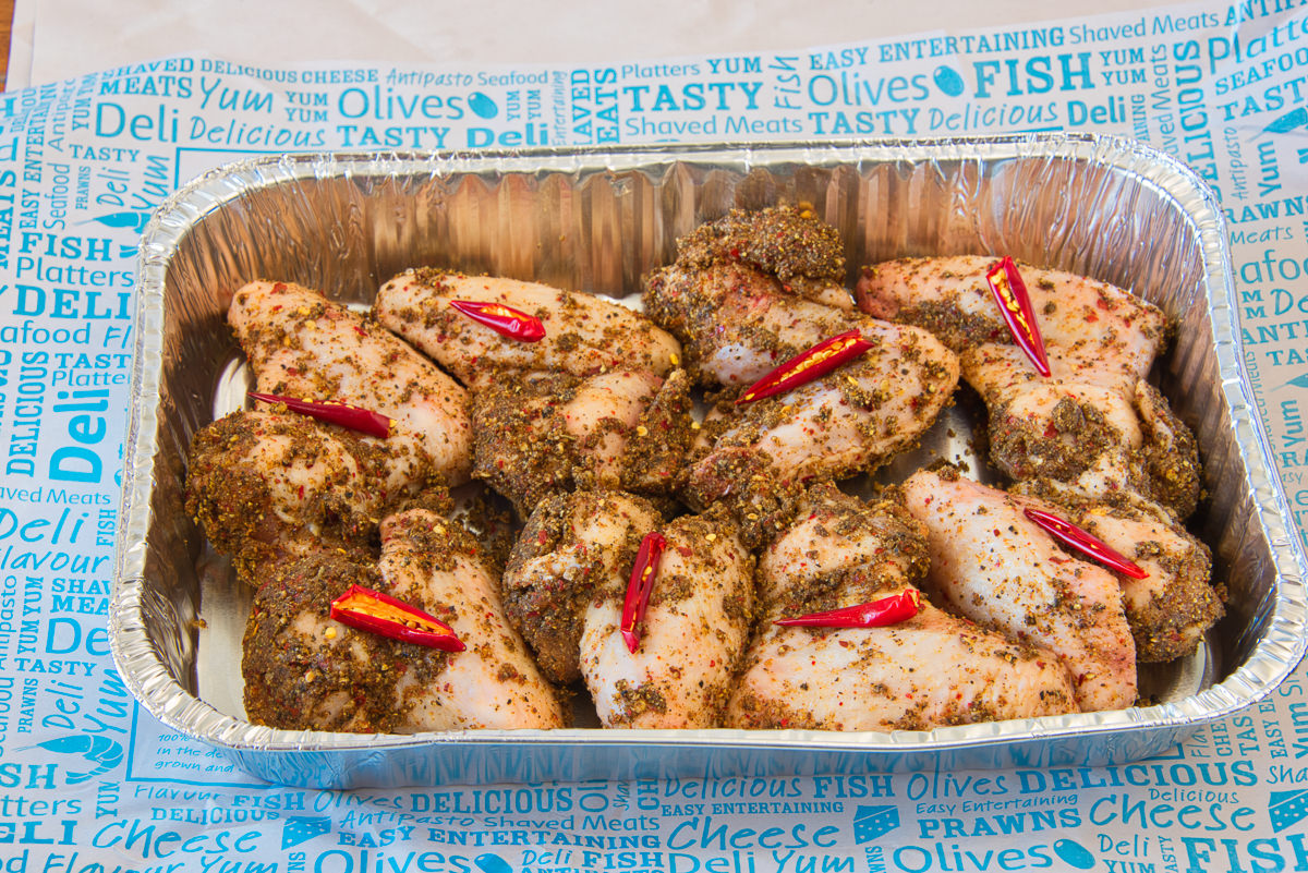 Blazing hot chilli and pepper nut crusted chicken wings ready for the oven Super hot and spicy chicken wings Gary Lum