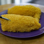 This is a photograph of the chicken Kiev pieces with the MEATER® inserted into one of them.