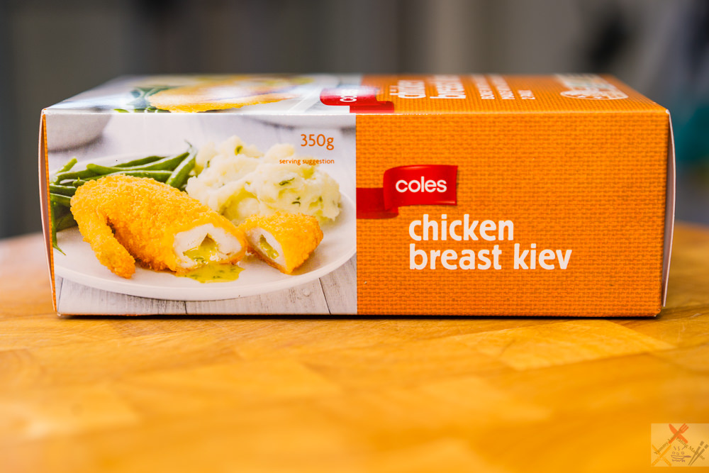 This is a photograph of a packet of Coles chicken Kiev. Two pieces per box.
