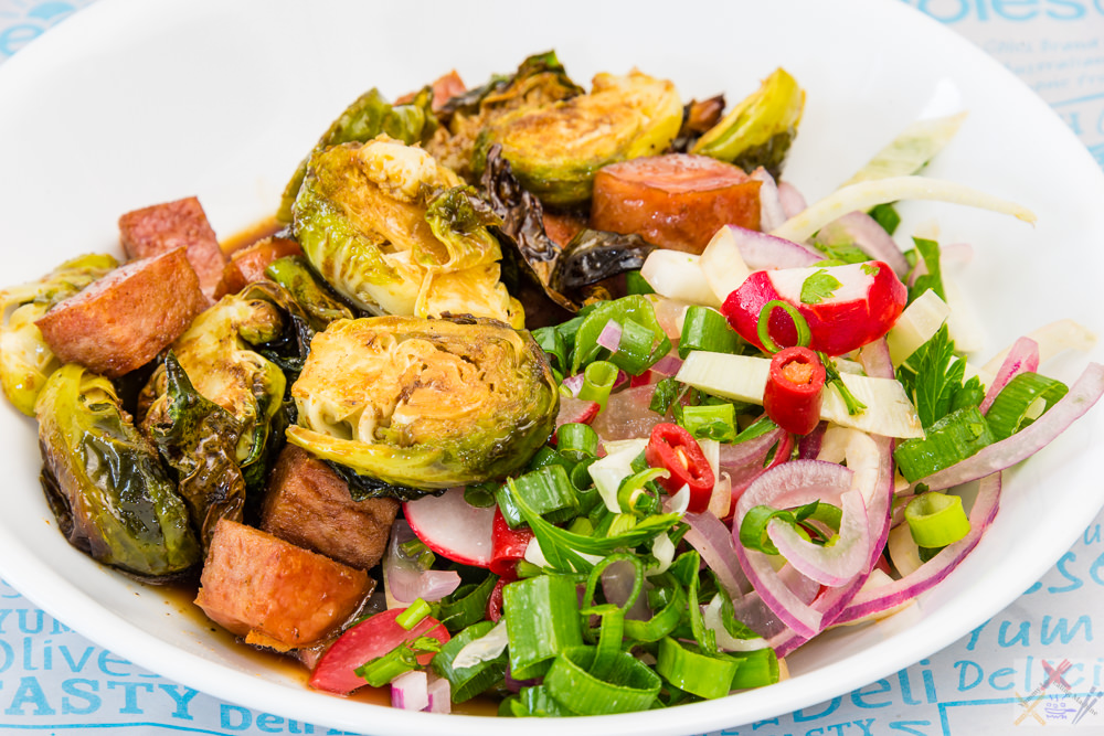 This is a photograph of my crispy Balsamic Brussels sprouts with Spam and spicy limey fennel salad 💚. The photo is quite colourful and shows the nice and crispy Brussels sprouts.