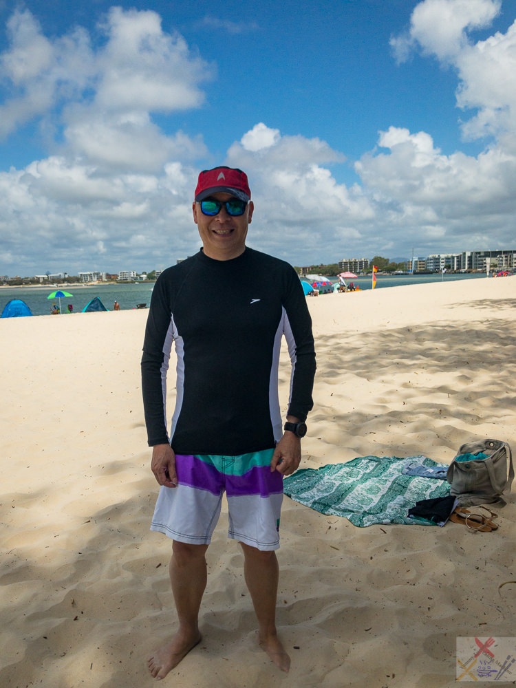 This is a photograph of me (Gary Lum aka Yummy Lummy) on the beach at Caloundra. I'm wearing a Star Trek cap, sunglasses, a long-sleeve rash vest and board shorts.