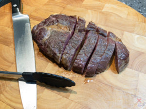 This is a photograph of the rare scotch fillet steak which I've cut into slices.