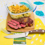 This is a photograph of my scotch fillet steak cooked rare with the cheesy creamy horseradish flavoured vegetables in a dish. The meat is cut and obviously rare.